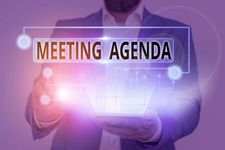 Handwriting text writing Meeting Agenda. Conceptual photo list of items that participants to accomplish at a meeting