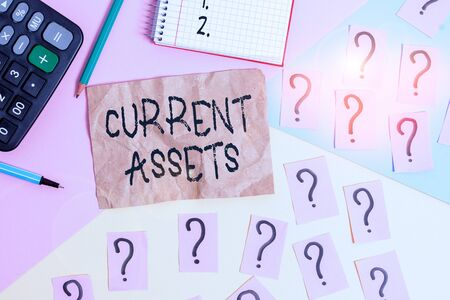 Word writing text Current Assets. Business photo showcasing any asset which can reasonably be expected to be sold Mathematics stuff and writing equipment above pastel colours background
