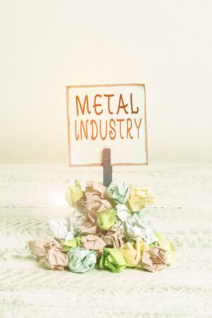 Word writing text Metal Industry. Business photo showcasing primarily concerned with metallurgy and metalworking Reminder pile colored crumpled paper clothespin reminder white wooden space Zdjęcie Seryjne