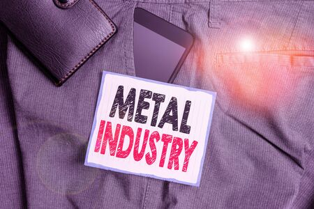 Text sign showing Metal Industry. Business photo showcasing primarily concerned with metallurgy and metalworking Smartphone device inside trousers front pocket with wallet and note paper