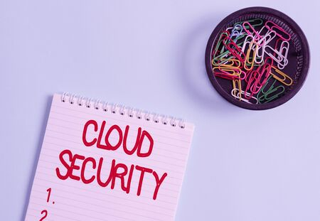 Conceptual hand writing showing Cloud Security. Concept meaning protection of data stored online from theft and deletion Blank notebook and stationary placed above pastel colour backdrop 스톡 콘텐츠
