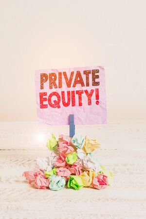 Writing note showing Private Equity. Business concept for the money invested in firms which have not gone public Reminder pile colored crumpled paper clothespin wooden space