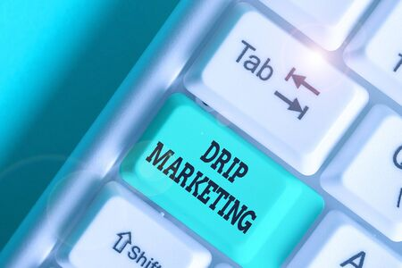 Writing note showing Drip Marketing. Business concept for sending promotional pieces to current and potential clients Zdjęcie Seryjne