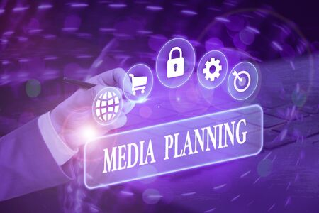 Writing note showing Media Planning. Business concept for the process of identifying and selecting media outlets