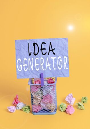 Writing note showing Idea Generator. Business concept for process of creating developing and communicating ideas Trash bin crumpled paper clothespin office supplies yellow