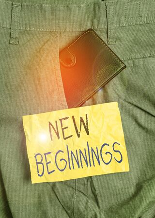 Word writing text New Beginnings. Business photo showcasing fresh look at the future and wonderful possibilities it holds Small little wallet inside man trousers front pocket near notation paper Stockfoto