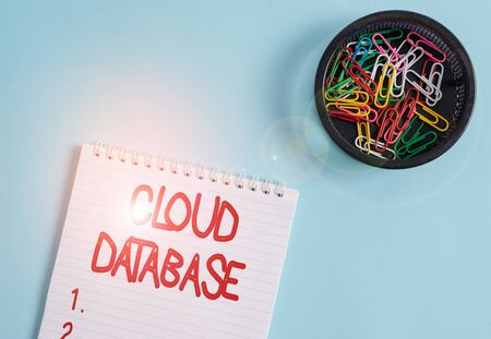 Conceptual hand writing showing Cloud Database. Concept meaning optimized or built for a virtualized computing environment Blank notebook and stationary placed above pastel colour backdrop