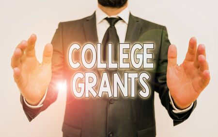 Word writing text College Grants. Business photo showcasing monetary gifts to showing who are pursuing higher education Male human with beard wear formal working suit clothes raising one hand up