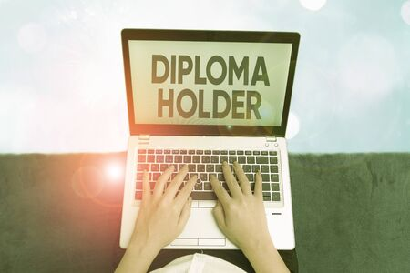 Word writing text Diploma Holder. Business photo showcasing a demonstrating successfully completed a particular course of study Stock Photo