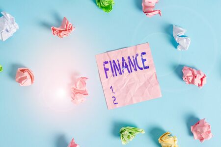 Handwriting text Finance. Conceptual photo Management of large government companies money amount Provide funds Colored crumpled rectangle shaped reminder paper light blue background