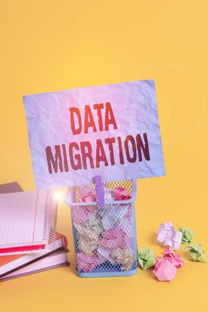Text sign showing Data Migration. Business photo showcasing process of transferring data between data storage systems Trash bin crumpled paper clothespin empty reminder office supplies yellow