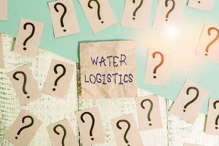 Handwriting text Water Logistics. Conceptual photo the management of the flow of things from port to consumer Scribbled and crumbling papers with thick cardboard above wooden table