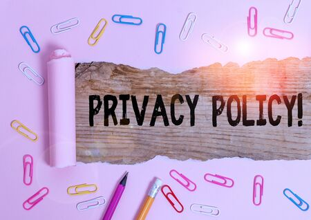 Text sign showing Privacy Policy. Business photo showcasing statement or a legal document that discloses clients data Stationary and torn cardboard placed above a wooden classic table backdrop