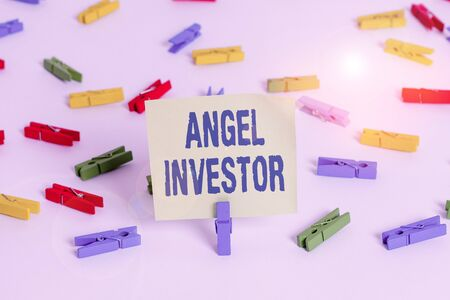 Word writing text Angel Investor. Business photo showcasing high net worth individual who provides financial backing Colored clothespin papers empty reminder white floor background office