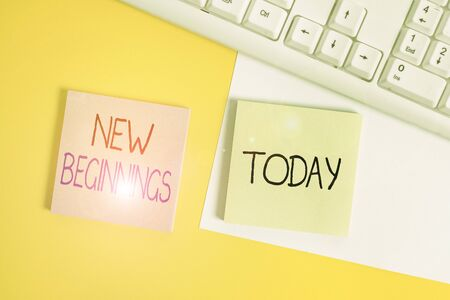 Handwriting text writing New Beginnings. Conceptual photo fresh look at the future and wonderful possibilities it holds Paper with copy space and keyboard above orange background table