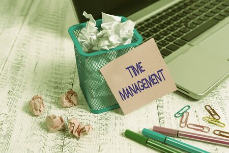 Word writing text Time Management. Business photo showcasing the ability to use one time effectively or productively Laptop sticky note waste basket crushed paper ball clips pens vintage table