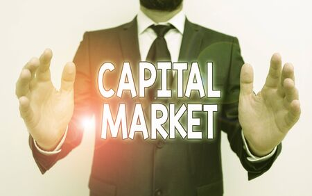 Word writing text Capital Market. Business photo showcasing the venues where savings and investments are channeled Male human with beard wear formal working suit clothes raising one hand up