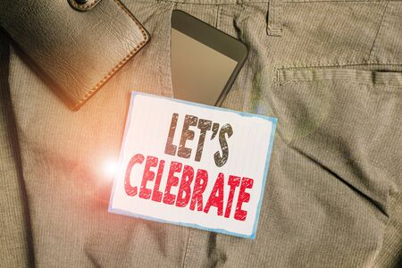 Text sign showing Let S Celebrate. Business photo showcasing party or other social event on a special day or occasion Smartphone device inside trousers front pocket with wallet and note paper