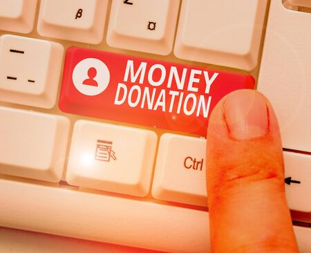 Writing note showing Money Donation. Business concept for something which someone gives to a charity or other