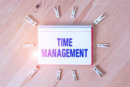 Handwriting text writing Time Management. Conceptual photo the ability to use one time effectively or productively Colored clothespin papers empty reminder wooden floor background office 版權商用圖片