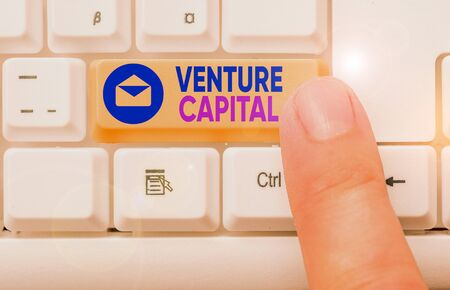 Conceptual hand writing showing Venture Capital. Concept meaning capital invested in a project in which there is risk Stock Photo