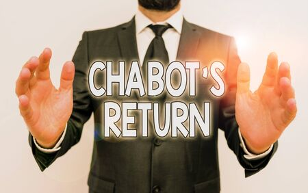 Word writing text Chabot S Return. Business photo showcasing the come back of conversation via auditory or textual method Male human with beard wear formal working suit clothes raising one hand up