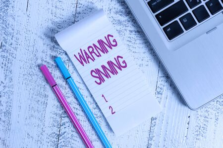 Text sign showing Warning Sinning. Business photo text stop the action which is believed to break the laws Trendy laptop blank ruled notepad pens lying wooden rustic vintage table Reklamní fotografie