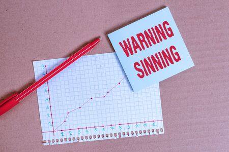 Handwriting text writing Warning Sinning. Conceptual photo stop the action which is believed to break the laws Desk notebook paper office cardboard paperboard study supplies table chart