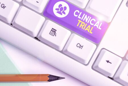Writing note showing Clinical Trial. Business concept for trials to evaluate the effectiveness and safety of medication