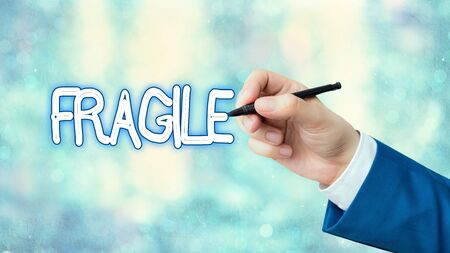 Writing note showing Fragile. Business concept for Breakable Handle with Care
