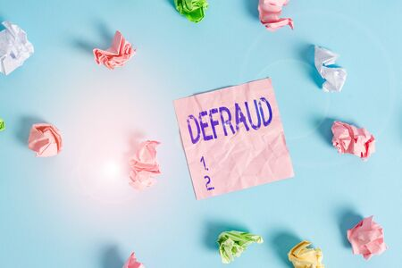 Handwriting text Defraud. Conceptual photo to trick or cheat someone or something in order to get money Colored crumpled rectangle shaped reminder paper light blue background