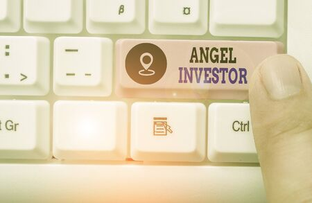 Conceptual hand writing showing Angel Investor. Concept meaning high net worth individual who provides financial backing