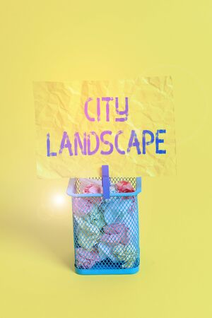 Text sign showing City Landscape. Business photo text photograph of the physical aspects of a city or urban area Trash bin crumpled paper clothespin empty reminder office supplies yellow