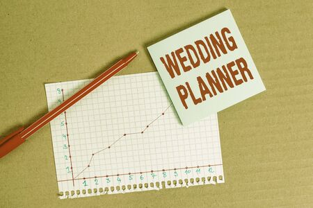 Handwriting text writing Wedding Planner. Conceptual photo someone who plans and organizes weddings as a profession Desk notebook paper office cardboard paperboard study supplies table chart Reklamní fotografie