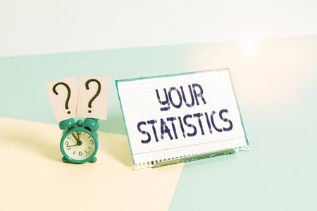 Text sign showing Your Statistics. Business photo showcasing information based on a study of the number of times Mini size alarm clock beside a Paper sheet placed tilted on pastel backdrop
