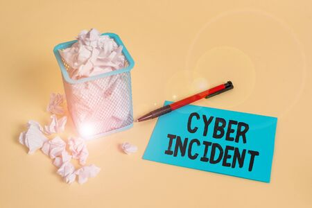 Word writing text Cyber Incident. Business photo showcasing warning that there may be a threat to information security crumpled paper trash and stationary with note paper placed in the trash can