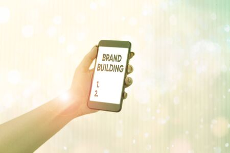 Writing note showing Brand Building. Business concept for activities associated with establishing and promoting a brand