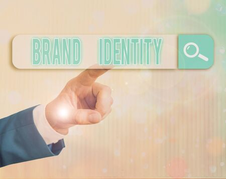 Writing note showing Brand Identity. Business concept for visible elements of a brand that identify and distinguish