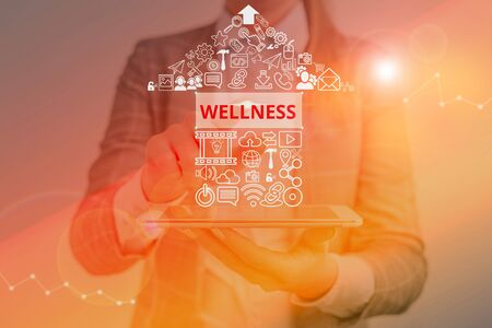 Writing note showing Wellness. Business concept for state of being in good health especially as actively pursued goal Imagens