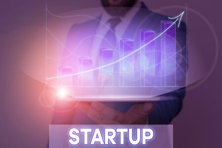 Writing note showing Startup. Business concept for the action of setting something in motion newly established business Banque d'images