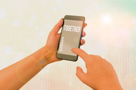 Conceptual hand writing showing Together. Concept meaning A close and harmonious relationship in which the showing or groups