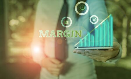 Writing note showing Margin. Business concept for amount by which revenue from sales exceeds costs in a business Imagens