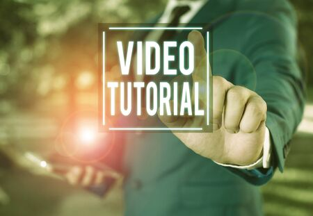 Handwriting text writing Video Tutorial. Conceptual photo method of transferring knowledge through audiovisual clips Businessman with pointing finger in front of him Stock Photo