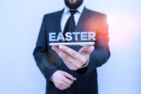 Handwriting text writing Easter. Conceptual photo the most important and oldest festival of the Christian Church Male human wear formal work suit hold smart hi tech smartphone use one hand