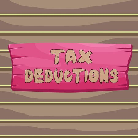 Conceptual hand writing showing Tax Deductions. Concept meaning amount or cost that can be subtracted from someone s is income Wooden board rectangle shaped wood attached color background