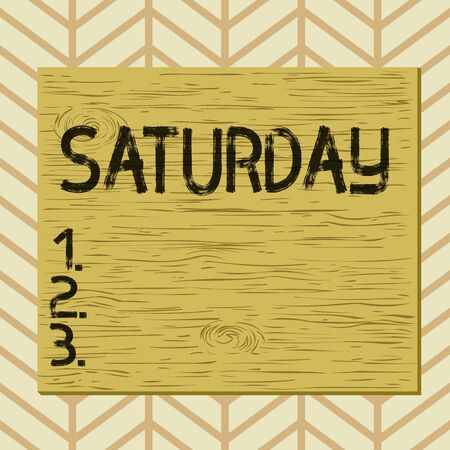 Writing note showing Saturday. Business concept for First day of the weekend Relaxing time Vacation Leisure moment Square rectangle unreal cartoon wood on the coloured wall Banco de Imagens