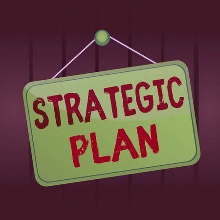 Writing note showing Strategic Plan. Business concept for analysisagement activity that is used to set and focus priorities Memo reminder empty board attached background rectangle