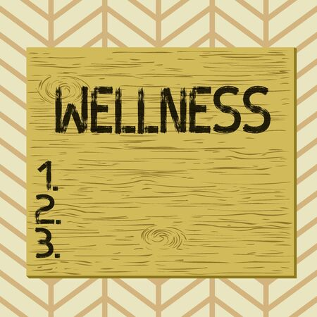 Writing note showing Wellness. Business concept for state of being in good health especially as actively pursued goal Square rectangle unreal cartoon wood on the coloured wall Standard-Bild