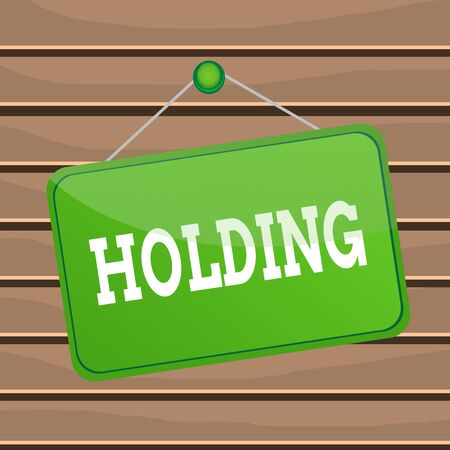 Conceptual hand writing showing Holding. Concept meaning stocks property and other financial assets in someone possession Memo reminder empty board attached background rectangle