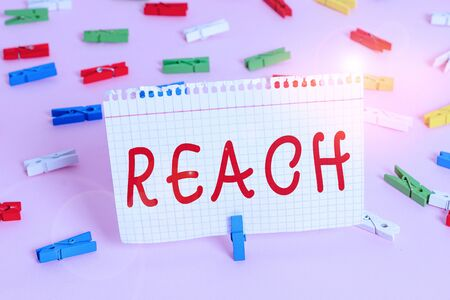 Handwriting text Reach. Conceptual photo the distance within which something can be touched or grabbed Colored clothespin papers empty reminder pink floor background office pin